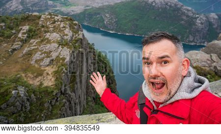 Pulpit Rock, Norway - June 2016: Tourist Taking A Selfie With Beautiful Norway Nature And Landscape