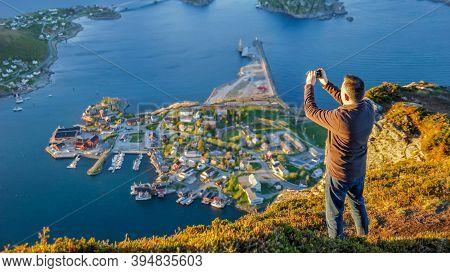 Reine, Norway - June 2016: Tourist Taking A Photo At Reinebringen, View On Stunning Mountains Of Lof