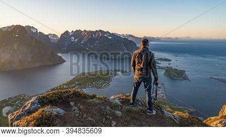 Reine, Norway - June 2016: Tourist On Top Of Reinebringen View On Stunning Mountains Of Lofoten Isla