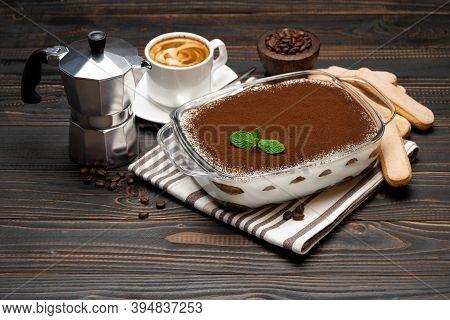 Traditional Italian Tiramisu Dessert In Glass Baking Dish, Coffee Maker, Savoiardi Cookies And Cup O