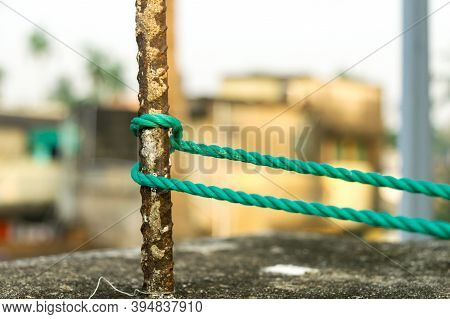 A Rope Is Tied In A Knot Around A Fence Post, Rope Tied Hitch Knots On A Rusty Iron Pole Isolated Fr