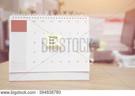Calendar On The Desk With Paper Note Is Working From Home. Concepts Is Stay Home Stay Safe And Socia