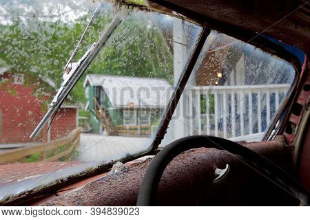 Looking Through The Dirty Windscreen Of A Deralict Vehicle In Telegraph Cove, Vancouver Island, Brit