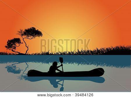 Man kayaking at sunset