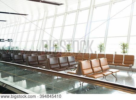 Empty Seats At The Airport Departure Terminal Lounge Waiting Area In The Morning With Sunlight.trave