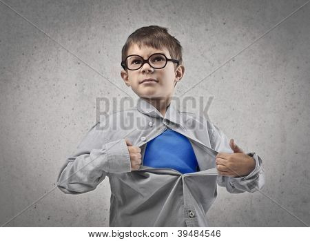Child opening his shirt like a superhero