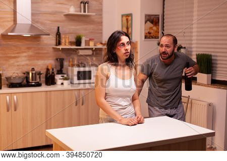 Husband Being Drunk Looking At Wife After Being Brutally Violent With Her. Violent Aggressive Man Ab