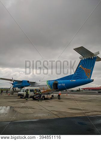 Dar Es Salaam, Tanzania - December 5, 2019: Baggage Is Unloaded From The Helicopter At The Airport.