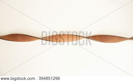 Leather Brown Strap On A White Background. Intertwined Strap.