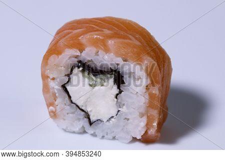 Food. Roll Philadelphia Sushi With Salmon On A Light Background. Close-up. Sushi Menu. Japanese Food