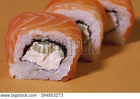 Food. Roll Philadelphia Sushi With Salmon On A Yellow Background. Close-up. Sushi Menu. Japanese Foo