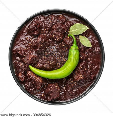 Dinuguan In Black Bowl Isolated On White. Spicy Filipino Cuisine Pork Blood Stew Dish With Meat. Asi