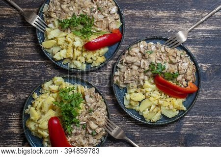 Roasted Wild Porcini Mushrooms And Fried Potatoes On Plate, Top View. Ukraine
