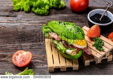 Trendy Raw Vegan Avocado Burger With Fesh Vegetables And Bacon, Egg, Ketogenic Diet Breakfast. Keto,