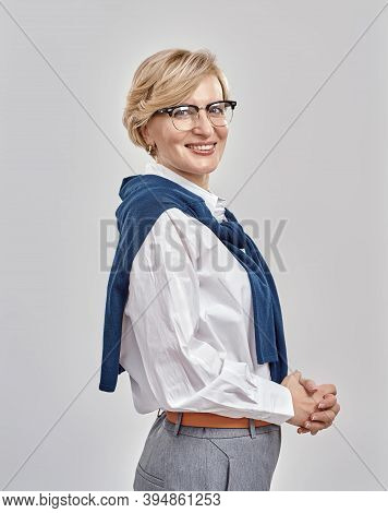 Portrait Of Elegant Middle Aged Caucasian Woman Wearing Business Attire And Glasses Smiling At Camer