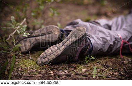 A Dead Man Body Lying On The Ground In The Woods. Murder In The Woods