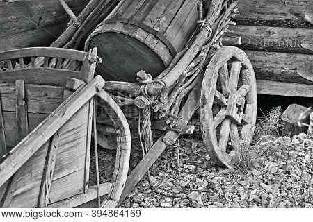 Animal-drawn Part Of A Wooden Vintage Transport Trolley With A Barrel And Sleigh A Closeup Of A Mono