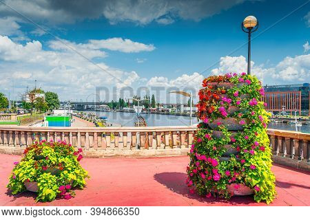 Flower Decoration On Long Bridge, Called Most Dlugi And View On Wieleckie Quay In Szczecin, Poland.
