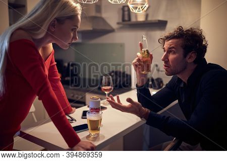 angry caucasian  wife arguing with her drunk husband