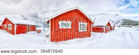 Wonderfull Winter Scenery With Traditional Norwegian Red Wooden Houses On The Shore Of Rolvsfjord On