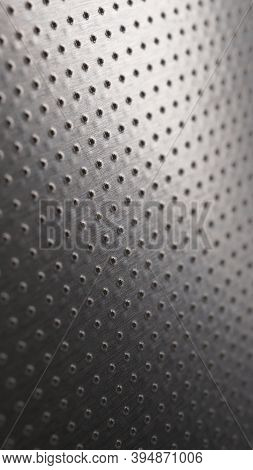 Dark Metallic Mobile Phone Wallpaper. Perforated Aluminum Surface With Many Holes. Abstract Industri
