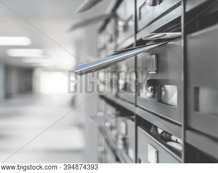 Mailboxes In The Condominium. Mailboxes Filled. Mail Boxes Filled Of Leaflets And Letters. Defocused