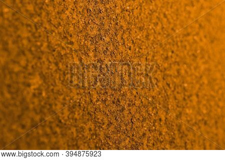 Bright Ocher Background Or Wallpaper. Horizontal Textured Backdrop. Rough Matte Surface. A Toned Sho