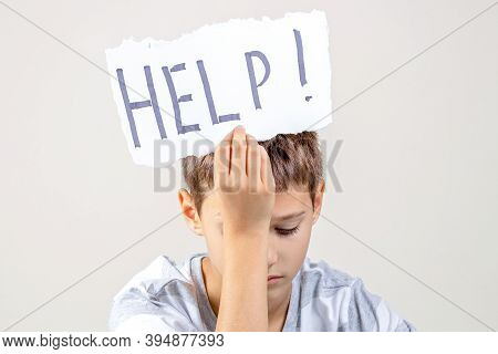 Sad Tired Frustrated Boy Holding Torn Paper Card With Word Help. Learning Difficulties, Kid Emotions