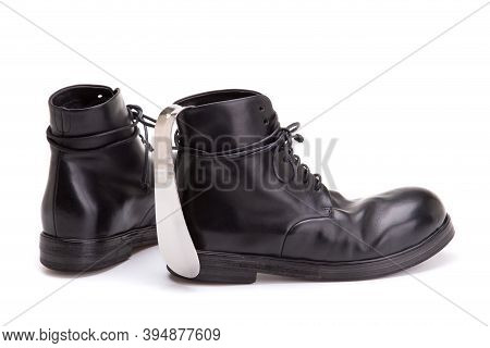 Pair Of Men's Shoes And A Silver Spoon For Shoes. Metal Shoe Spoon. Shoe Spoon And Large Black Leath