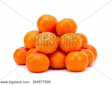 Heap Of Ripe Tangerines On A White Background. Tangerines Close Up. Tangerines Isolate On A White Ba