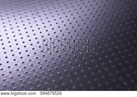 Dark Industrial Metallic Background. Tinted Violet Or Purple Wallpaper. Perforated Aluminum Surface