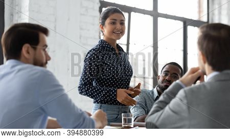 Confident Indian Businesswoman Convincing Thoughtful Multiethnic Business Partners On Negotiations