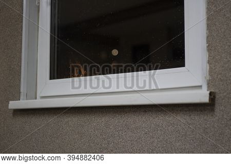 Plastic Window In The House. Window Sill Corner. Windows Made Of White Plastic.