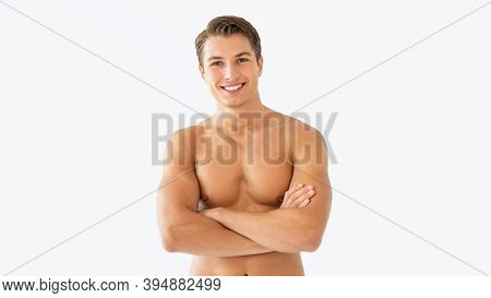 Confident Fit Man. Portrait Of Attractive Muscular Man With Naked Torso And Smooth Skin Standing Wit