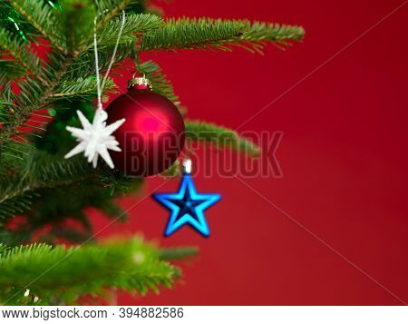 Christmas ornaments on a Christmas tree on red background