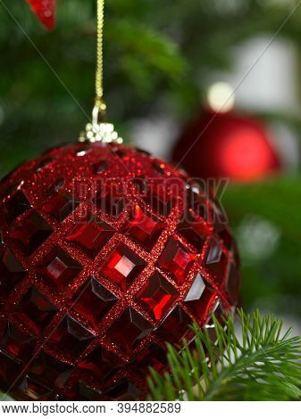 Red ball Christmas ornament on a Christmas tree
