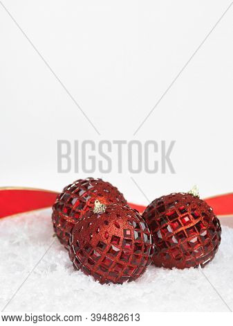 Red balls Christmas decoration still life on white background with snow