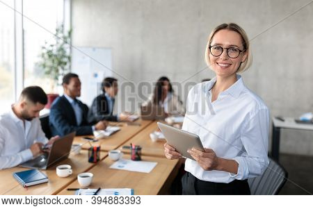 Successful Businesswoman Hr Holding Digital Tablet Smiling To Camera Standing Near Desk With Diverse