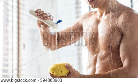 Male Everyday Hygiene And Bodycare Concept. Unrecognizable Man Pouring Shower Gel On Sponge Washing