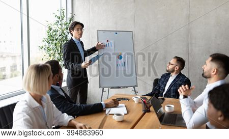Asian Businessman Giving Speech On Corporate Meeting, Making Business Presentation For Coworkers And