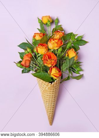 Fresh Yellow-orange Roses In A Waffle Cone On A Pink Background. Copy Space, Flat Lay. Original Pack