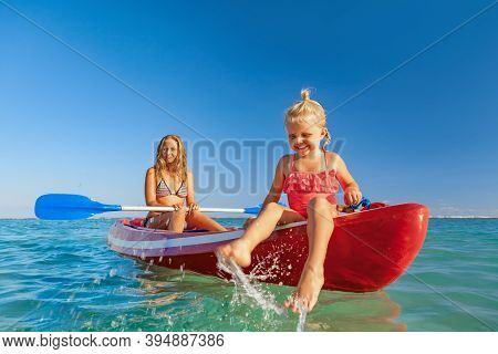 Happy Family - Young Mother, Children Have Fun On Boat Walk. Woman And Child Paddling On Kayak. Trav