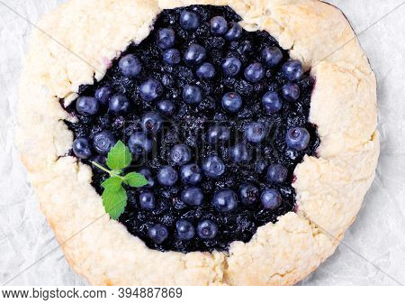 Shortbread Galette With Bilberry On The Baking Parchment. Top View