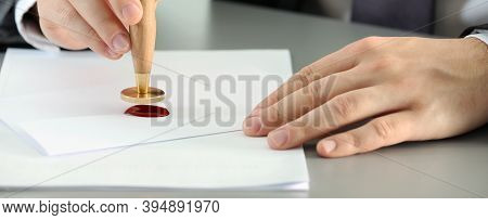 Notary Stamping Document At Table, Closeup. Banner Design