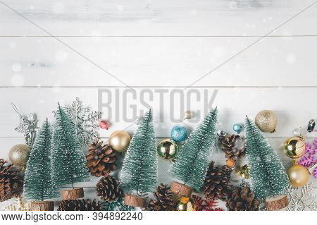 Christmas Background With Decorations On White Wood Background, Snowflakes. Xmas And Happy New Year
