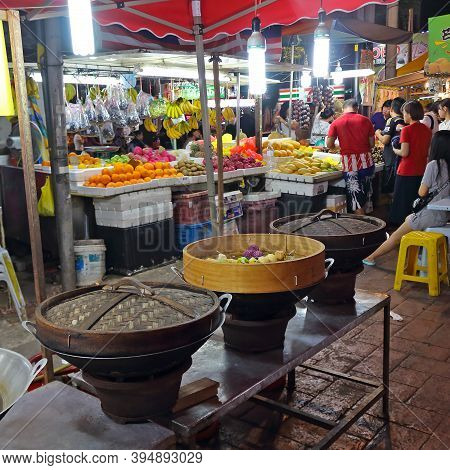 Kuala Lumpur, Malaysia - March 15, 2019: Steamed Dumplings Cooking In Wooden Steamer. Dim Sum For Sa