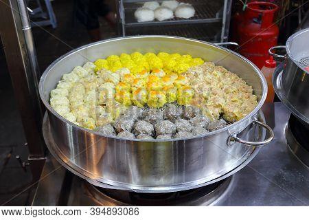 Steamed Dim Sum For Sale. Chinese Dumpling In A Metal Steamer. Jalan Alor Night Street Food In Kuala