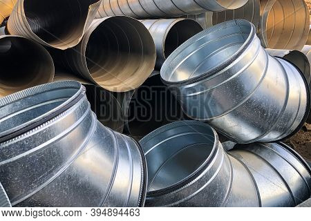 Halvanized Ventilation Pipe Elbows. Industrial Metal Pipes
