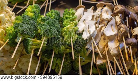 Broccoli And Mushrooms On Skewers For Barbecue At Jalan Alor Food Street In Kuala Lumpur. Popular As