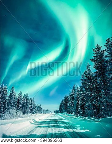 Colourful Northern Lights In Night Sky. Multicoloured Green Vibrant Aurora Borealis Polaris, Norther